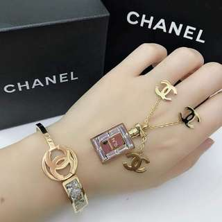 channel one set earings and bangles
