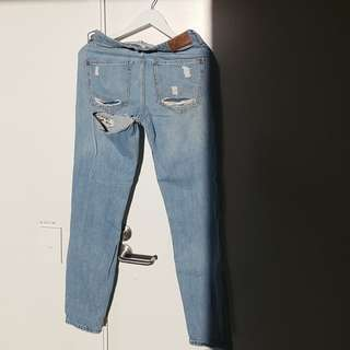 Ripped bum River Island blue jeans