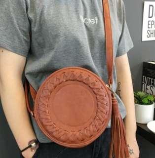 round sling tassel bag