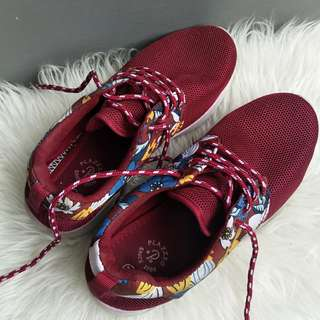 Red flowery running shoes