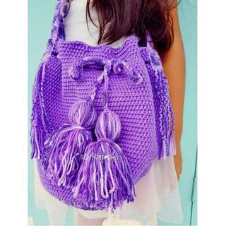 Purple sling bag with tassles