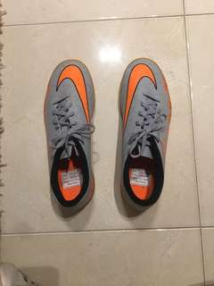 Grey and Orange Nike shoes
