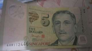 Selling my $5 singapore error printing note