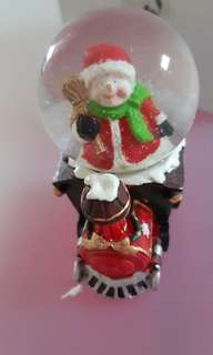 Santa's Claus in snowflakes bubble