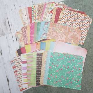 More than 150 pieces of scrapbooking paper