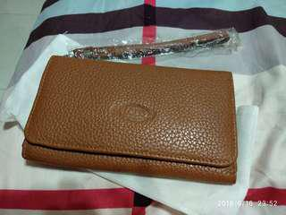Brand new leather handphone clutches