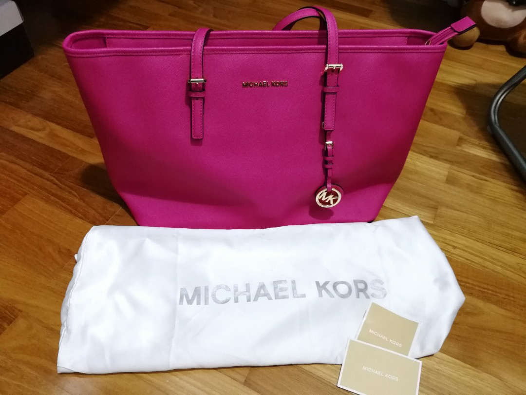 c494268eaf7d0 inexpensive michael kors travel tote hot pink 1a552 15271