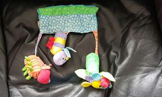 Stroller toy with jingle