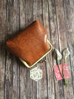 Brown color coin purse