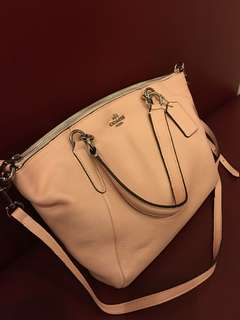 Authentic coach with flaw discolouration in the side the handle