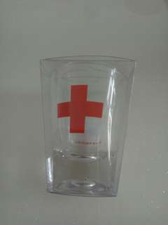 Shot glass with first aid sign