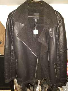 Brand new leather with fur inside coat with tags