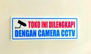 Papan nama toko ini di lengkapi camera cctv