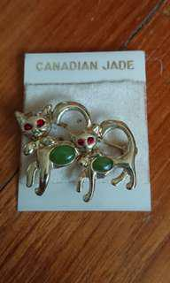 Vintage brooch featuring two cats