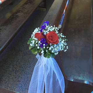 Red roses for church pews