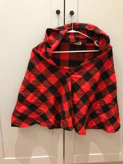 Red hooded checkered cape