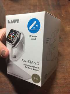 LAUT Apple Watch stand. Gold colour