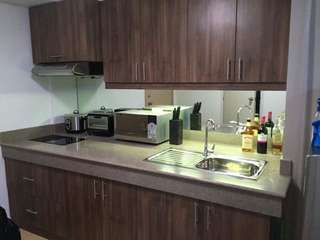 Quezon City Fully Furnished Condominium with Parking for Sale