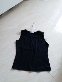 A black lady top...made in France.  Elastic material