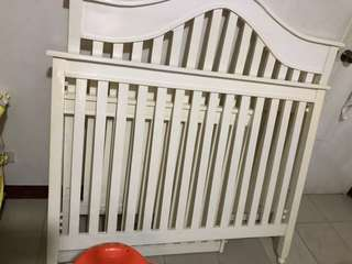 Wooden crib with accent chair