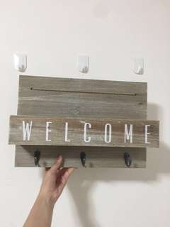 Welcome Sign With Hooks and Basket