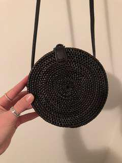 Black round woven bag