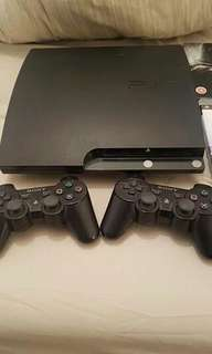 Playstation 3 With 2 controllers and lots of games