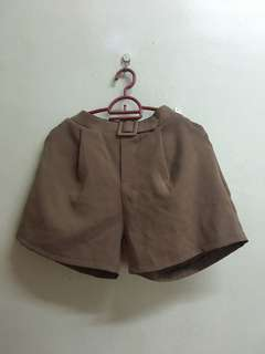 Brown short with tag. Suitable M-L