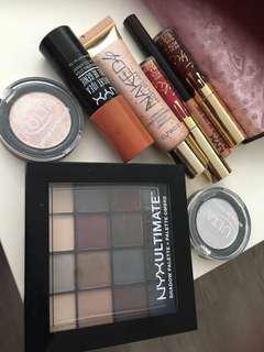 Two Kylie lipstick, 1 NYX eyeshadow kit, 2 glitter eye coat, 1 cheek illuminator