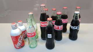 Coca cola collections ( 12 bottles )