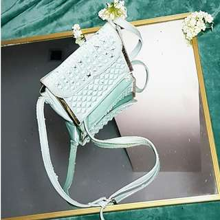 SM Mint colored studded sling bag