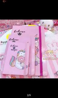 Unicorn notebook and pen