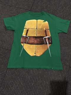 Nickelodeon Ninja Turtle Shirt from the USA. Almost new. Hand wash only. Not worn out. Color green with nice front and back print.
