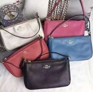 💯% authentic Coach wrislet/crossbody wallet bag