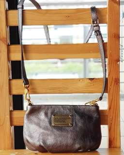 Like new Authentic Marc Jacobs Pewter Crossbody Zippered Sling