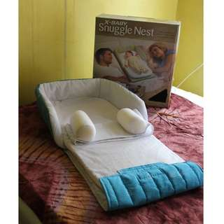 X baby Snuggle Nest Co-sleeper