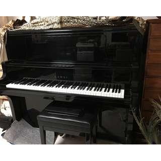A KAWAI exam piano