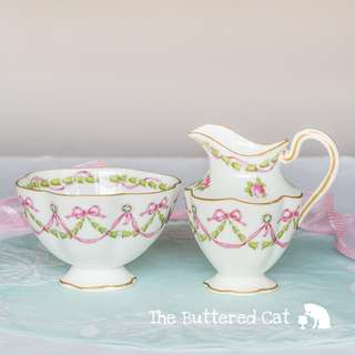 Stunning antique English bone china milk jug and sugar bowl, pink ribbon bows and roses, swags and garlands