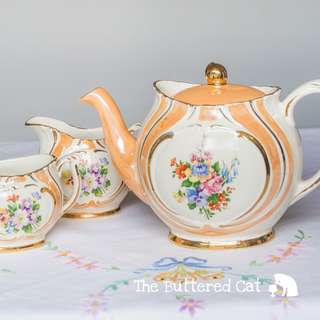 Lovely vintage peach lustre floral teapot with matching creamer, collectible teapot, HTF pattern and shape