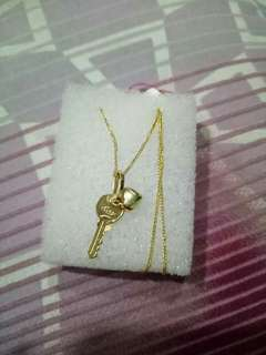 18k yellow gold necklace with key and heart pendant