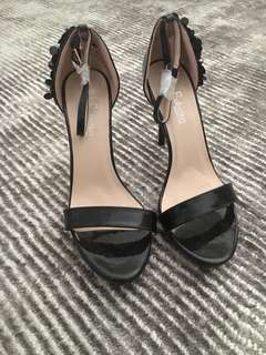 Brand new bought in Europe black heels with flower detail on side size 40
