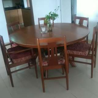 Solid teak dining table with 10 chairs.