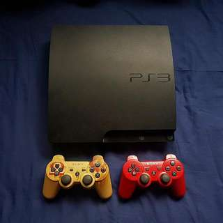PS3 Slim Console + 3 Dualshock controllers (Inc. God Of War Edition)