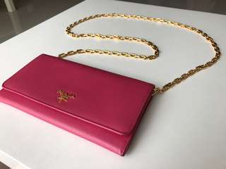 Prada pink wallet and gold sling bag