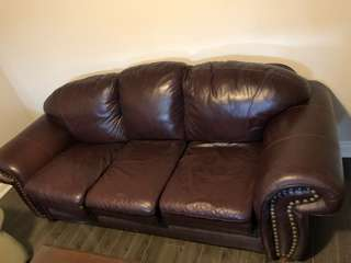 Brown leather couch set plus coffee table