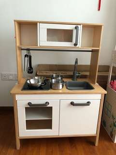 Ikea kids kitchen with pots and thongs