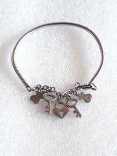 Rare Stainless steel semi-bangle charmed bracelet