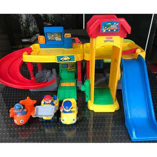 Little People toy garage with ramps