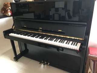 Upright piano. Very well kept and tuned regularly. Like new.