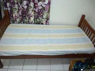 Solid wood bed frame with mattress